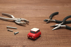 Miniature car and maintenance tools on wood. 