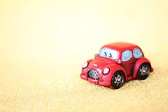 Miniature car model on gold glitter lighting background with copy space ready for adding or mock up royalty free stock image