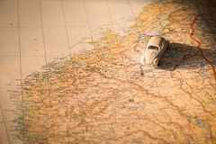 Miniature car on the Norway map, concept of holiday trip. Miniature car on the Norwegian map, concept of holiday trip Stock Image