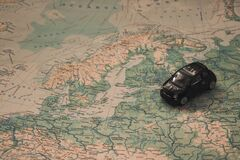 Miniature car over map of Baltic Royalty Free Stock Images
