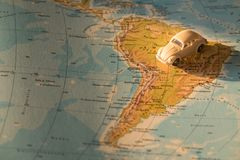 Miniature car on the South America map, concept of holiday trip. Miniature car on the map, concept of holiday trip royalty free stock image