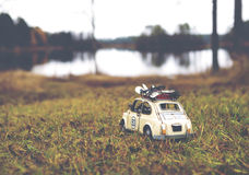 Miniature car traveling around the globe. royalty free stock photography