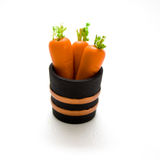 Miniature Carrots in Barrel Royalty Free Stock Photography