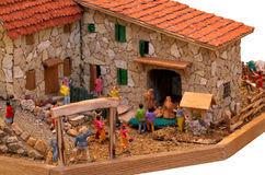 Miniature characters in a village that go to the Holy Family Stock Photography