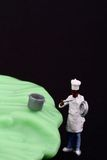 Miniature of chef and salad leaf Royalty Free Stock Photos