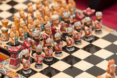 Miniature chess. Minute chess figures lined up on a board, Sacred Valley, Peru Royalty Free Stock Images