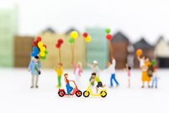 Miniature children: Boys cycling play fun in the playground. Image use for Children`s day.  Royalty Free Stock Photography