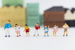 Miniature children : Group children standing with town center. Image use for study international, back to school concept.  Stock Image