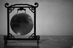 Miniature of Chinese Gong in Black and white. Photo of miniature of chinese gong under the light of sun, in Black and white Stock Image