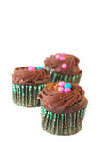 Miniature chocolate cupcakes. Miniature decorated chocolate cupcakes on white background Stock Photo