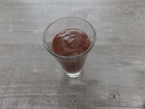 Chocolate mascarpone mousse in a glass. Miniature chocolate mascarpone mousse served in a small shot glass royalty free stock photos