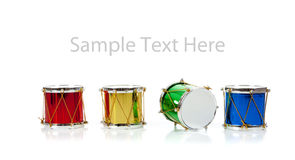 Miniature Christmas drums on white with copy space Royalty Free Stock Image