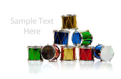Miniature Christmas drums on white with copy space Royalty Free Stock Images
