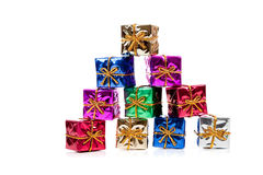 Miniature Christmas presents on white Stock Images