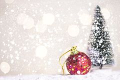 Miniature Christmas Santa cros and Tree on snow over blurred bokeh background,Decoration Image for Christmas Holiday and Happy New Stock Image
