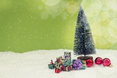 Miniature of christmas tree with colored gifts Royalty Free Stock Photography