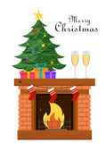 Miniature Christmas tree with gifts under it stands on the fireplace Royalty Free Stock Photo