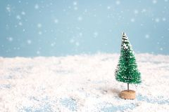 Miniature Christmas Tree with snowfall. Copy space for text. Hol. Miniature Christmas Tree with snowfall. Copy space for text. Winter card. Holiday and Royalty Free Stock Images