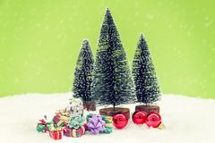 Miniature of christmas trees with colored gifts Stock Photos