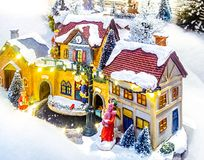 Miniature Christmas village scene. Christmas decorations toys. Stock Photography