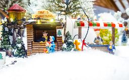 Miniature Christmas village scene. Christmas decorations toys. Royalty Free Stock Image