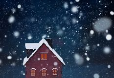 Miniature Christmas village scene with toy wooden house Royalty Free Stock Image