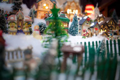 Miniature Christmas Village under Xmas Tree Stock Images