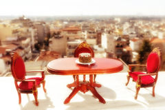 miniature classical dining on a marble floor Stock Images