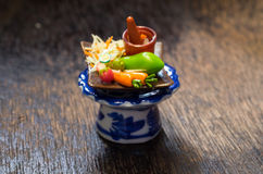 Miniature Clay of Papaya Salad Thai with vegetables on the glass Royalty Free Stock Photos