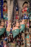 Miniature clay pitchers hanging in a store royalty free stock photos