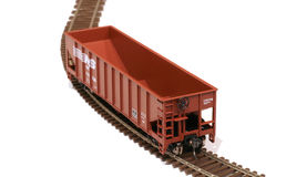Miniature Coal Hopper. Image of a brown HO (1:87) scale coal hopper on a track isolated on white royalty free stock photography