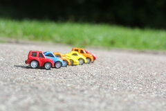 Miniature colorful cars standing in line on road sale concept Royalty Free Stock Photo