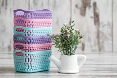Miniature Colorful Plastic Baskets for Household Use. On white background Royalty Free Stock Images