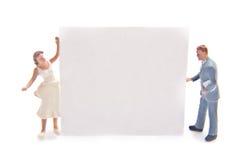 Miniature con il segno in bianco Fotografia Stock Libera da Diritti