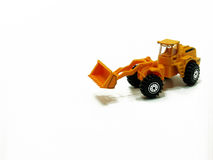 Miniature construction vehicle. A model construction vehicle is a scale model that represents a construction vehicle such as a front-loader Stock Image
