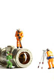 Miniature construction workers plumbing valve Stock Photo