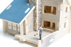 Miniature couple : Couple looking at their dream house Royalty Free Stock Images