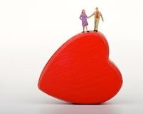 Miniature of a couple of lovers into an heart-shaped box Stock Image