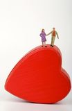 Miniature of a couple of lovers into an heart-shaped box Royalty Free Stock Image