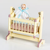 Miniature cradle Stock Photo