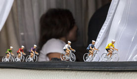 Miniature Cyclists. Alpe-D'Huez,France- July 18, 2013: Miniature cyclists decorating the window of a caravan on the road the road to Alpe D'Huez, during the Stock Photography