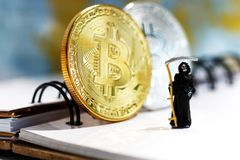 Demon of death. Miniature: Demon of death standing with bitcoin. Financial and business concept Stock Photography