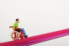 Miniature of a disabled man Stock Photos