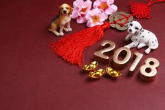 Miniature dogs with chinse new year decorations 2018 - Series 11 Royalty Free Stock Photos