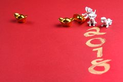 Miniature dogs with gold ingots and year 2018. Written in gold royalty free stock photos