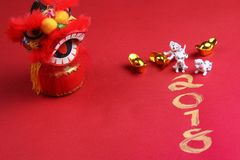 Miniature dogs with chinese new year decorations. Miniature dogs with lion head as decorations for chinese new year 2018 royalty free stock images