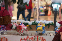 Miniature doll buggies  on conveyor belt in shopping center Royalty Free Stock Photography