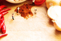 Miniature dolls making spicy with space for text Stock Photos