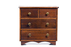 Miniature Dresser. Miniature wooden chest of drawers drawers. White background Stock Photos