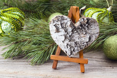 Miniature easel with bark heart, pine branches and Christmas dec Stock Image